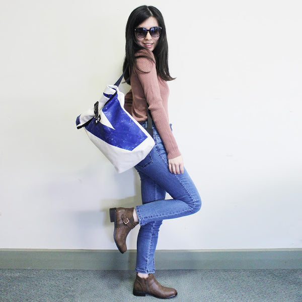 blue and white backpack by m24 bags