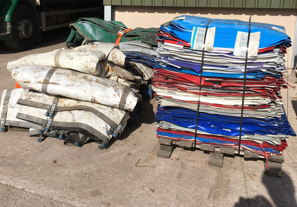 pallet of lorry curtains stacked for m-24 bags