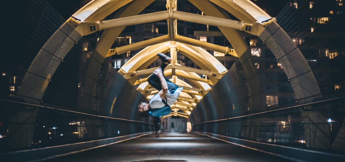 backflip on a bridge with a backpack by m-24