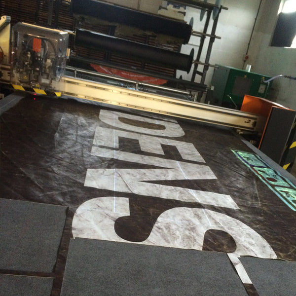 black lorry tarpaulin cutting by M24 bags, using a laser cutting machine