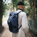 Nomadic People Zuberi Roll Top Rucksack In Indigo on Navy