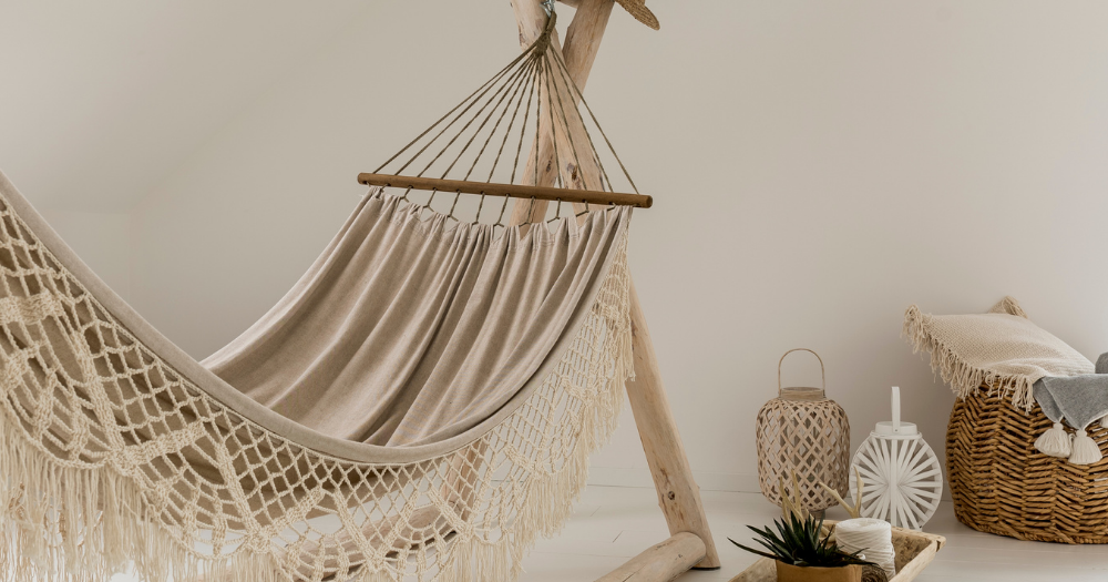 beige nicaragua hammock hanging indoors on a wooden stand next to interior decor