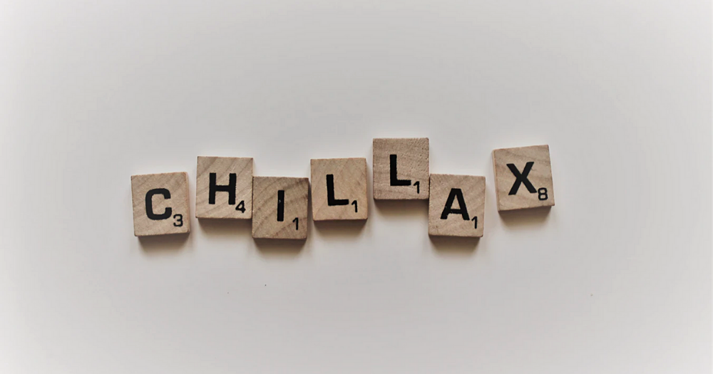 chillax in scrabble letters on a white background