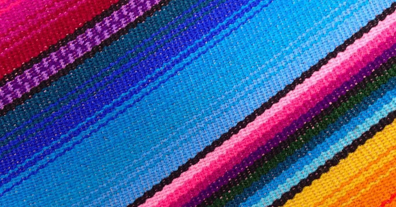 Textured, colourful hammock fabric.