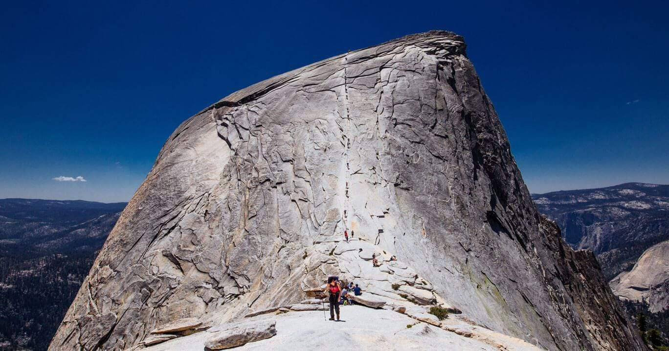 Hikers climb the peak at Yosemite National Park