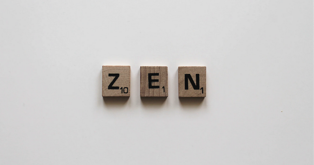 zen written in scrabble letters on a white background