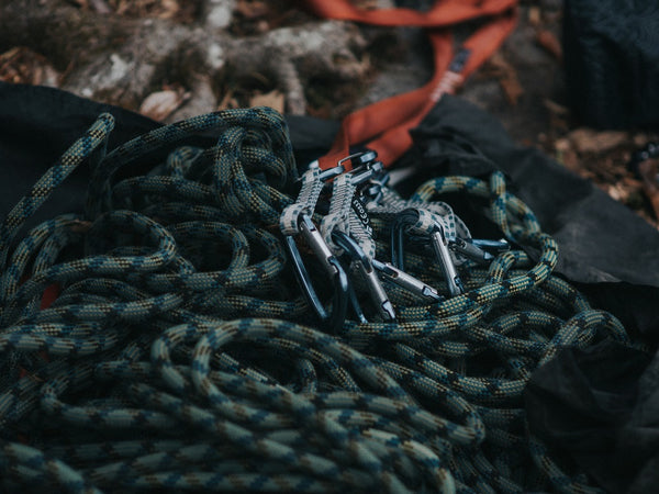 Ropes and carabiners are seen on the ground