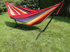 Colourful brazilian hammock on a black universal stand