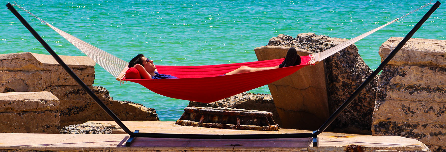 hammock universe man in a red hammock by the ocean