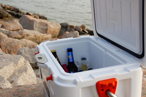 White cooler with drinks in it