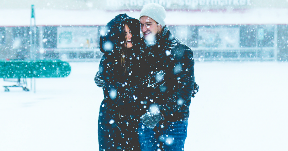 couple walking around outside in the snow