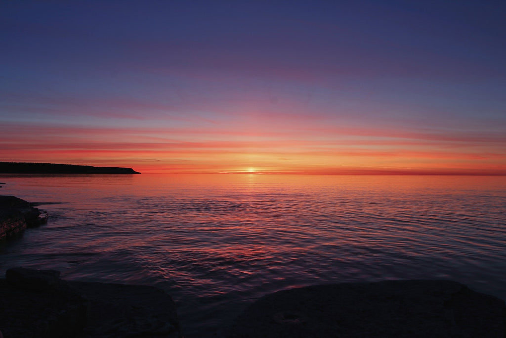 A sunset view of the Georgian Bay and Lake Huron, looking off Dyer's Bay on the Bruce Peninsula in Ontario.