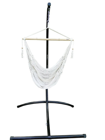 Black metal standalone hammock stand with white cotton rope hammock attached.