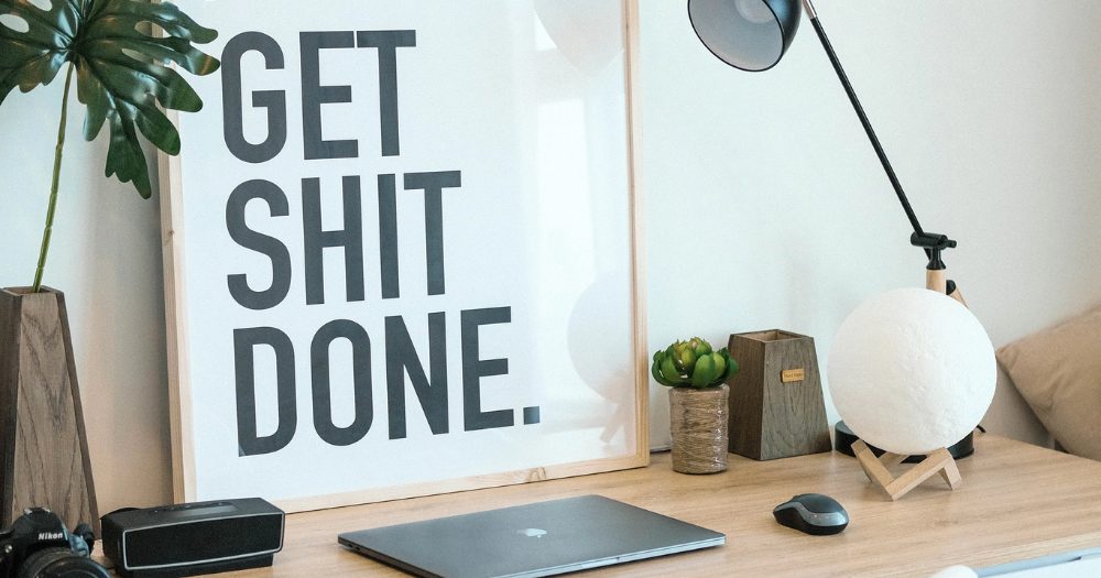 at home office with a sign that says get shit done