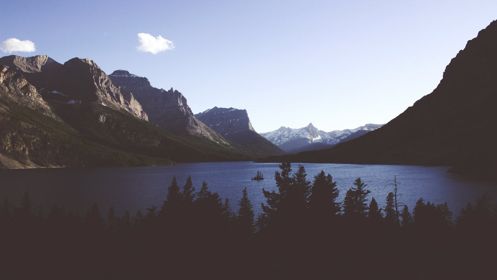 Landscape photography of mountain and body of water in Glacier National Park.