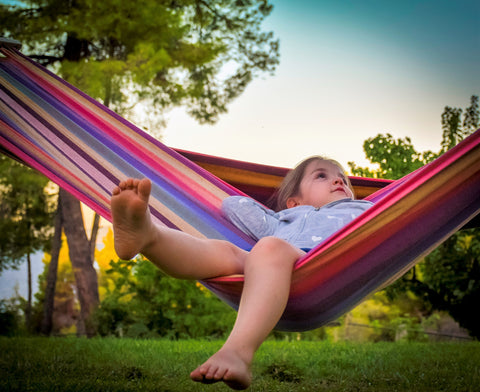 Child plays in Brazilian hammock safely