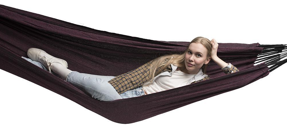Girl hangs in Hammock Universe Deluxe Brazilian-Style Hammock in black and pink
