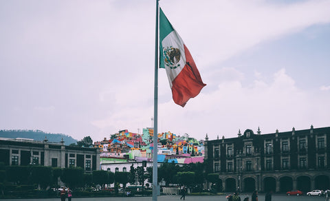 Mexican flag in the middle of a town