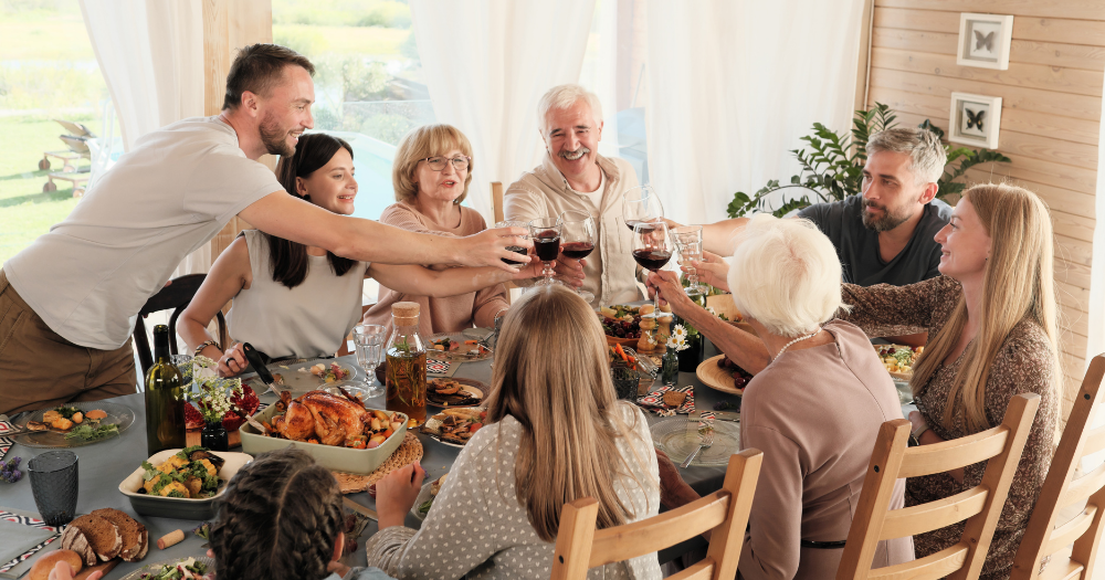 large family cheers' at the dinner table over a grand feast