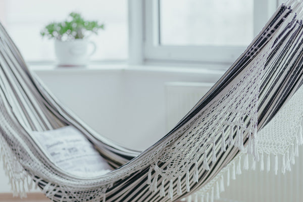 Delicieux A Blue And White Stripped Linen Hammock Hangs Indoors Suspended From The  Ceiling.