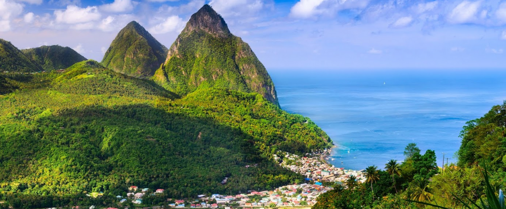 St. Lucia view of mountains with ocean and village in the background