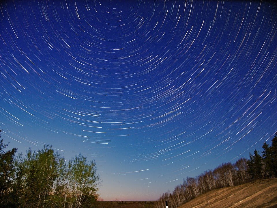 Stars swirl in a stylized Manitoba sky at night.