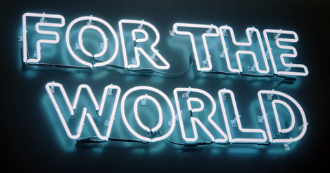 """Blue neon sign that says """"For the World"""""""
