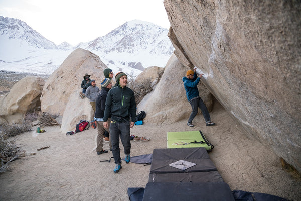 Climbers inspect their gear and surrounding area before they rock climb