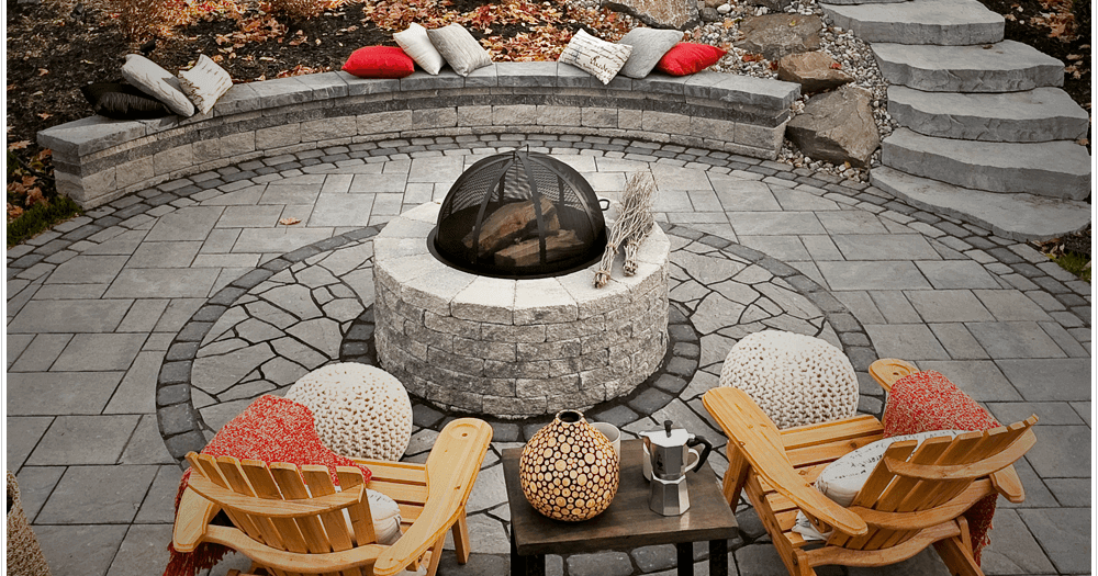 cozy fire pit with muskoka chairs on an interlock patio