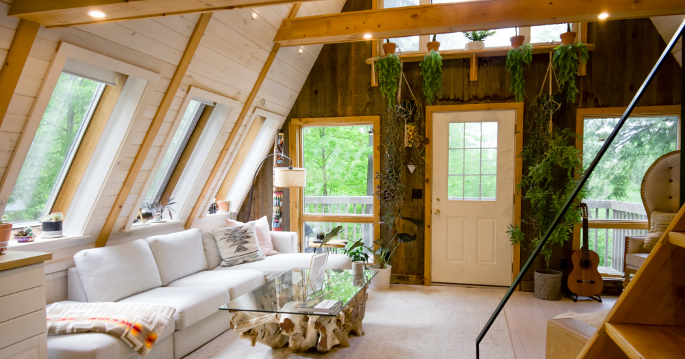 living room with exposed beams and wooden ceilings