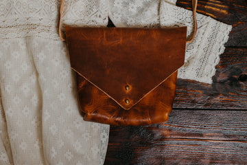 rugged tan leather crossbody bag