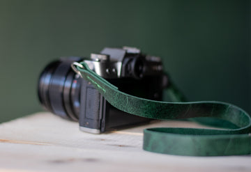 green leather camera strap
