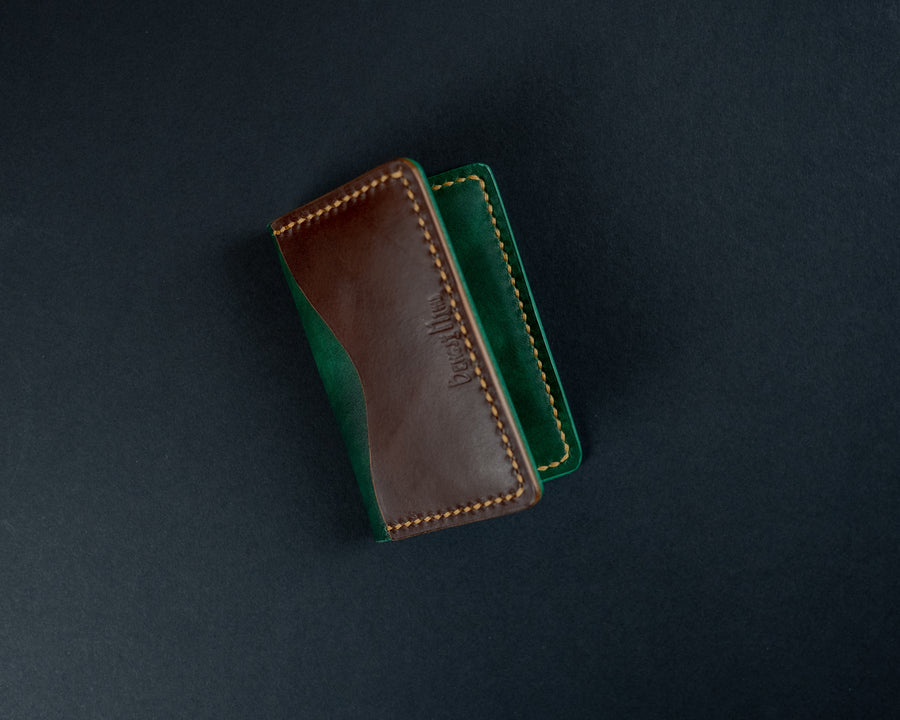 green and brown leather wallet