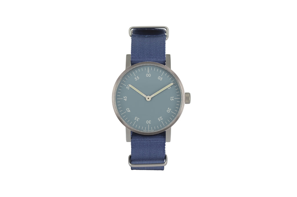V03B Basic Round Analog Watch