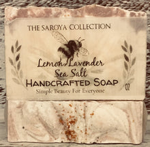 Load image into Gallery viewer, Lemon-Lavender Sea Salt Soap - The Saroya Collection-has calming effects  on the skin, body & mind. 100% natural & topped with a touch of lavender buds. It smells like walking through the lavender fields of Provence, soothing & so intoxicating to the senses. This soap is naturally scented with lemon + lavender essential oil.