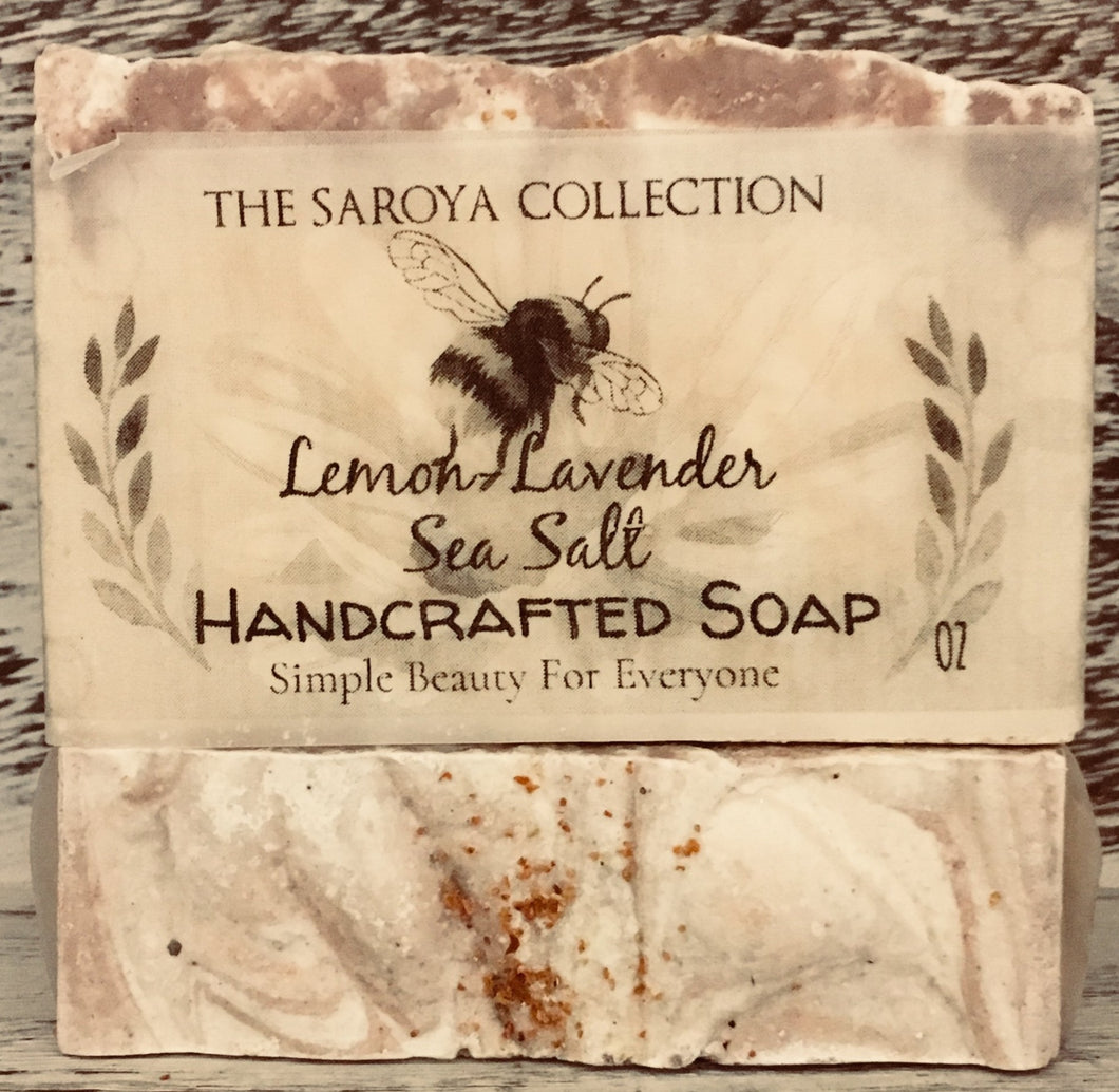 Lemon-Lavender Sea Salt Soap - The Saroya Collection-has calming effects  on the skin, body & mind. 100% natural & topped with a touch of lavender buds. It smells like walking through the lavender fields of Provence, soothing & so intoxicating to the senses. This soap is naturally scented with lemon + lavender essential oil.