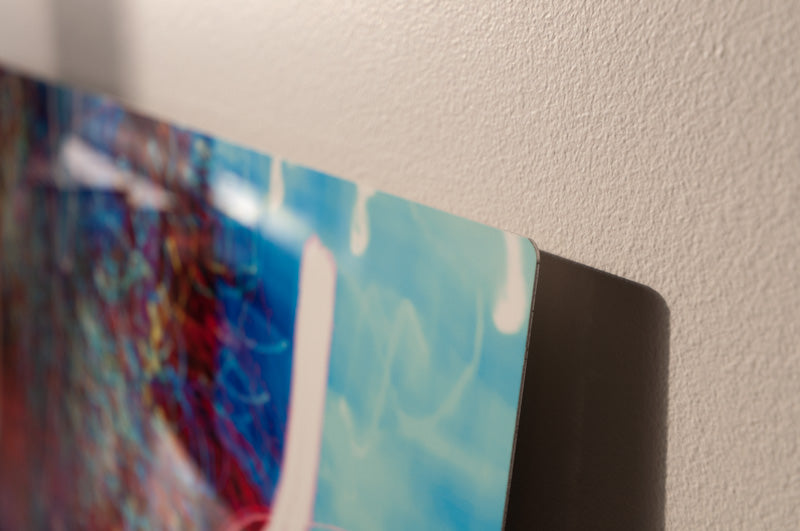"Prints are made on 1mm (1/25"") aluminum sheet with 3/16"" rounded corners."