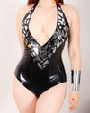 Latex Black Mirror bodysuit with chrome effect pieces.
