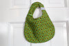 It's the BiBitty - Brio - A Montessori and Waldorf Inspired Self Feeding Bib