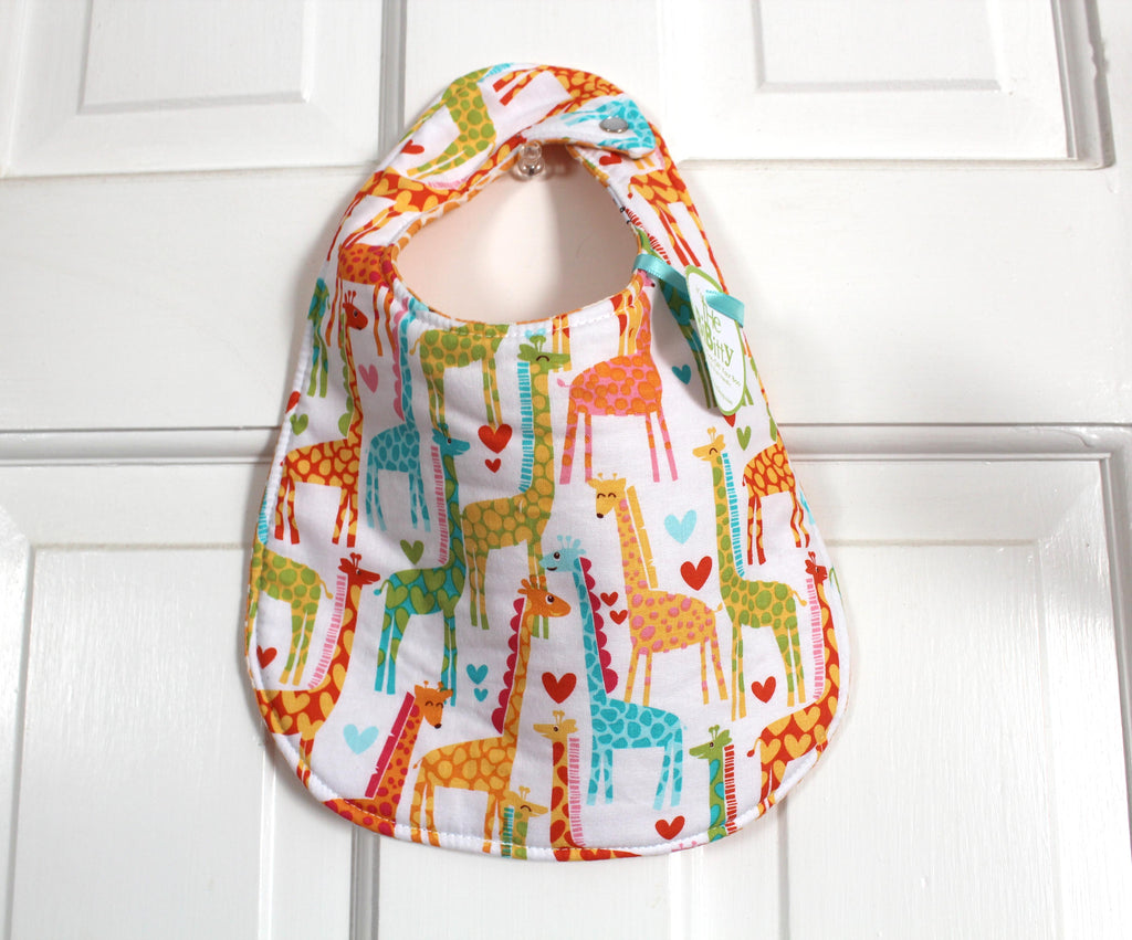 It's the BiBitty - Tropical Giraffes - A Montessori and Waldorf Inspired Self Feeding Bib