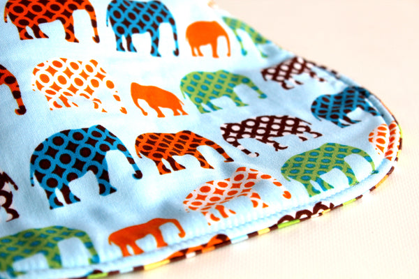 It's the BiBitty - Blue Elephant Parade - A Montessori and Waldorf Inspired Self Feeding Bib
