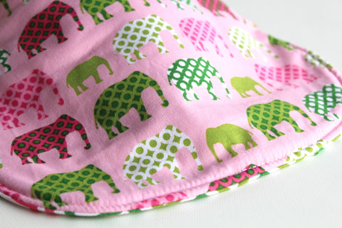 It's the BiBitty - Pink Elephant Parade - A Montessori and Waldorf Inspired Self Feeding Bib