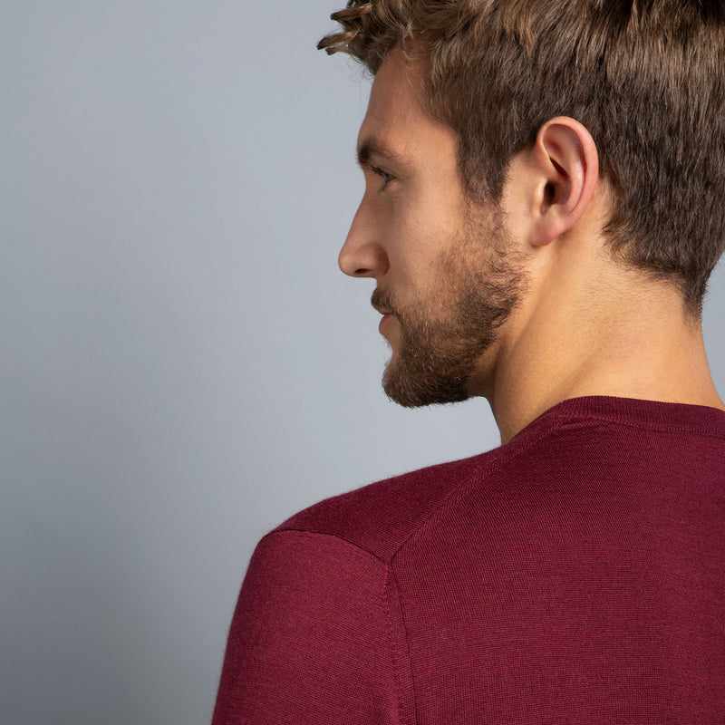Extra Fine Merino Wool Crewneck in Burgundy Red, detail of shoulder on model – FILOFINO Luxury Italian Knitwear