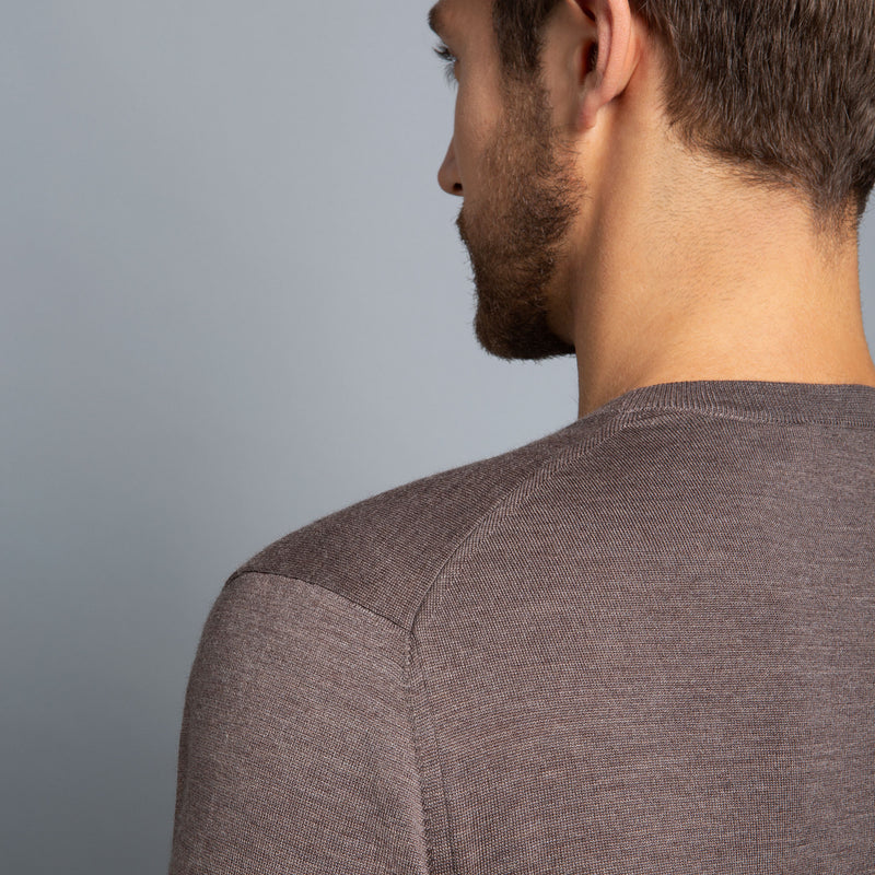 Extra Fine Merino Wool Crewneck in Hazelnut, detail of shoulder on model – FILOFINO Luxury Italian Knitwear