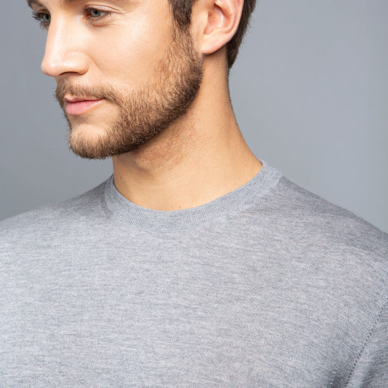 Extra Fine Merino Wool Crewneck in Light Grey, detail of collar on model – FILOFINO Luxury Italian Knitwear