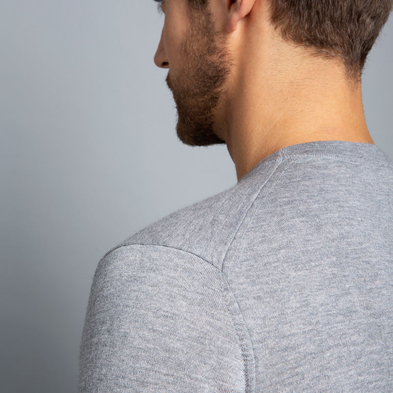 Extra Fine Merino Wool Crewneck in Light Grey, detail of shoulder on model – FILOFINO Luxury Italian Knitwear