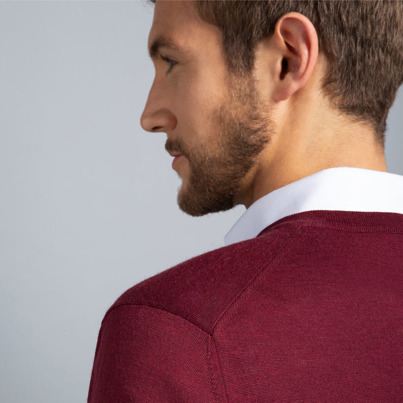 Extra Fine Merino Wool V-Neck in Burgundy Red, detail of shoulder on model – FILOFINO Luxury Italian Knitwear