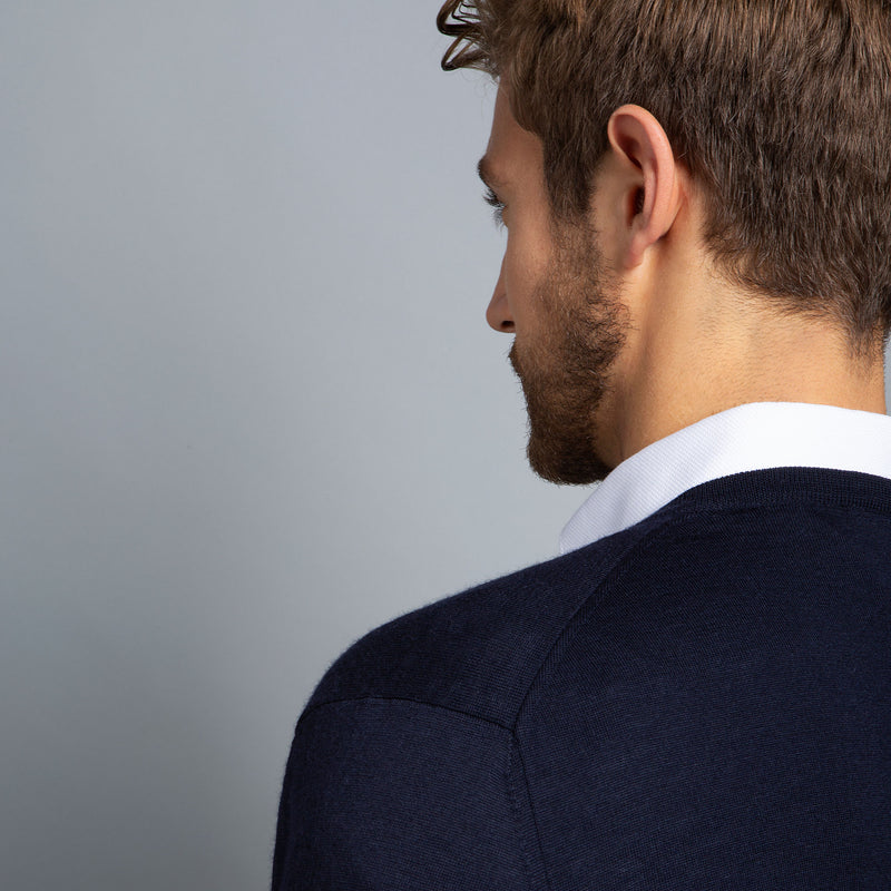 Extra Fine Merino Wool V-Neck in Navy, detail of shoulder on model – FILOFINO Luxury Italian Knitwear