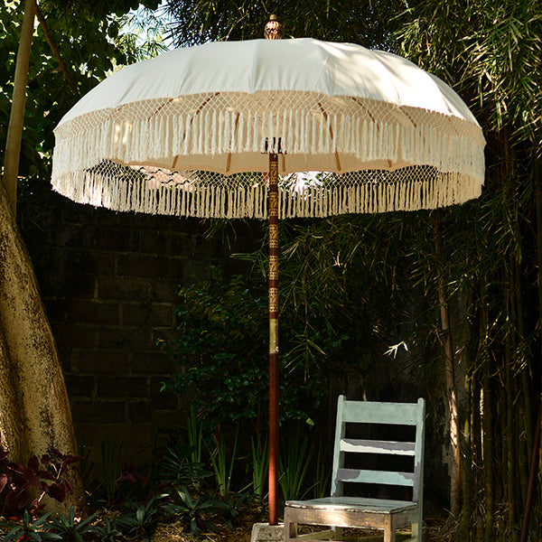 Balizen's Balinese Umbrellas: Authentic Balinese umbrellas made with cotton. Choose from eco-friendly fabric prints or natural one-toned fabric. Each umbrella is decorated beautifully with intricate Bali macrame tassels and charms.