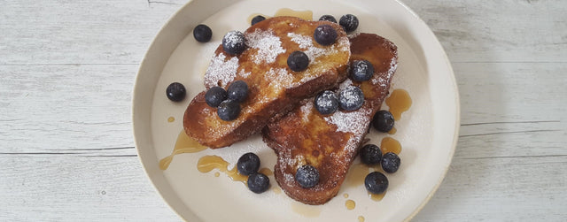 French toast with fresh fruit and maple syrup